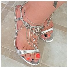 ✨Sexy✨ Silver Italina Slinky Heel Sandals Gorgeous Silver Italina High Heel Slinky Sexy Sandals. Lots of Sparkly Rhinestones and sure to catch everyone's eye. Create a fantastic look and pair up with some capris for a high fashion celebrity look!!! Italiana Shoes Heels