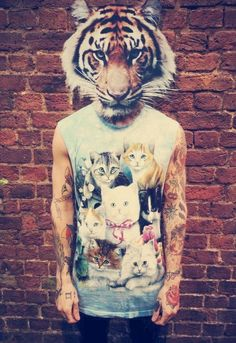 this guy took a kitten shirt and made it badass by having a tiger head and having tats