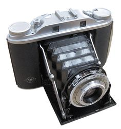 Agfa Isolette III. This was our family camera when we were growing up. I inherited it when dad got a Canon EOS SLR.