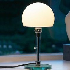 Wagenfeld lamp. One day I'm going to own one and it's going to sit on an Eileen Gray table. Cliche, but who cares?