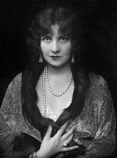 """A simple strand of pearls really is jewelry that has timeless elegance.  As fashionable today as they were a century ago.  We have them!  They come in a variety of sizes from """"Choker"""" all the way to """"Opera"""", like the one shown."""