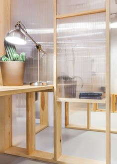 Wooden frames and polycarbonate sheets create semi-transparent workspaces