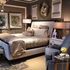 Hanging artwork above your bed can make the headboard feel taller. This is a good way to visually bring the ceiling height down if you have very tall ceilings.