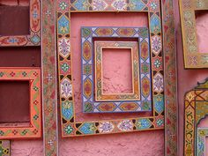 Marrakeah frames against a pink stucco wall