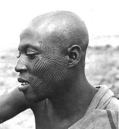 Africa | Man with traditional facial scarification.  West Africa, ca 1941 | ©John Atherton