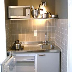Guest/bedroom/basement Kitchenette--perfect for small spaces. Small sink, 2 burner stove. Would use a full size fridge and overhead cupboards