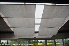 fabric draped over bamboo rods. Could this be adapted to disguise fluorescent tube ceiling fixtures.
