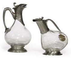 TWO FRENCH PEWTER-MOUNTED GLASS CLARET JUGS