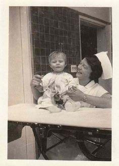 Vintage photo of a nurse with a baby, circa 1910s-20s. 50 Vintage Photos of Nurses Being Awesome #Nursebuff #Vintage #Nurse