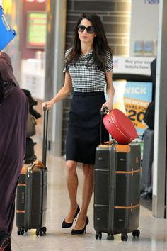 Arriving at Heathrow Airport in 2014. See all of Amal Clooney's best looks.