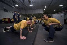 Sailors participate in a semi-annual physical fitness assessment in the hangar bay of the aircraft carrier USS Dwight D. Eisenhower (CVN 69), the flagship of the Eisenhower Carrier Strike Group.