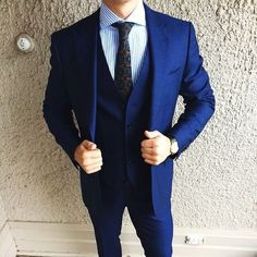Hard proof that a navy three piece suit and a blue vertical striped dress shirt look amazing when teamed together in a refined outfit for today's gentleman. Sharp Dressed Man, Well Dressed Men, Blue Three Piece Suit, Look Formal, Formal Wear, Blue Shirt Dress, Striped Dress, Dress For Success, Suit And Tie
