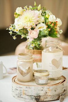 Mason jar wedding centrepieces - DIY wedding planner with ideas and tips including DIY wedding decor and flowers. Everything a DIY bride needs to have a fabulous wedding on a budget! Mason Jar Centerpieces, Rustic Wedding Centerpieces, Wedding Table Centerpieces, Flower Centerpieces, Mason Jars, Wedding Decorations, Centerpiece Ideas, Vases, Pots Mason