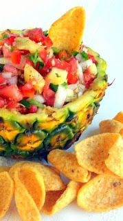 "Pineapple Jalapeño Salsa ~~~1 part Red Bell Pepper 1 part Vidalia Sweet Onion 1 part fresh Pineapple 2 parts Tomatoes 1/2 part Jalapeños 1/2 part ""Not Your Grandmother's Herbes de Provence"" Juice of 2 small limes (or one big one) 1/4 part fresh chopped Cilantro And simply mix well and... ENJOY!!!"