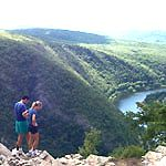 Hikers atop a mountain looking down at the river - Delaware Water Gap  National Recreation Area  NJ,PA