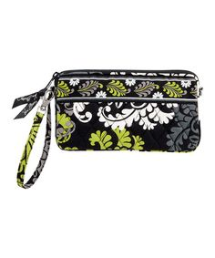 Slip some style over the wrist for an instant dose of fabulous. This soft cotton wristlet boasts one of Vera Bradley's highly coveted retired patterns and an expanding gusseted interior with all kinds of organization potential. Note: This item features a retired pattern.