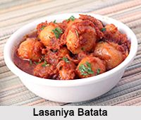 Lasaniya Batata is a spicy garlicky recipe with baby potatoes from the Gujarati cuisine. For more visit the page. #indianfood #vegetarian #recipes