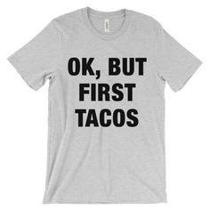 Ok, But First Tacos T-Shirt. This super-soft, baby-knit t-shirt looks great on both men and women – it fits like a well-loved favorite. #Tacos