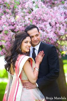An Indian bride and groom take some portraits before their reception.
