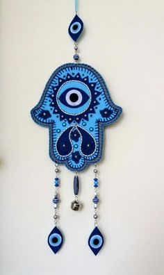 Hamsa Wall decor for home. Hamsa Hand Amulet. Symbolizing the Hand of Gog, in all faiths it is a protective sign. It brings it's owner happiness, luck, health, and good fortune.