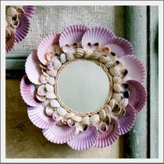 2 family members hold commercial shell fishing liscenses, so there are LOTS of scallop shells...this is another lovely use of them...the small round mirror is sweet.