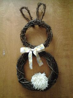 My March Hare Wreath. The head and body are pre-made grapevine wreaths. The ears were made from a small grapevine swag I took apart and reformed.