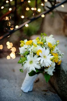 love this bouquet! I must have those yellow pom pom flowers.  White and yellow seem to be my fav.