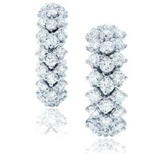 Flexible rings 54 round brilliant diamonds by Harry Winston