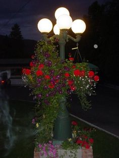 4 Arm 5 Light Cast Aluminum Street Lamp Post With Round Globes And A Black Finish Outdoor