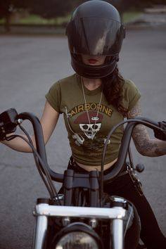 """""""The Women's Moto Exhibit promotes this new type of badass woman,"""" MacNoughton says. """"Harley Davidson has put wind in my sails, enabling me to live my dream of riding cross country with my friends.""""   - ELLE.com"""