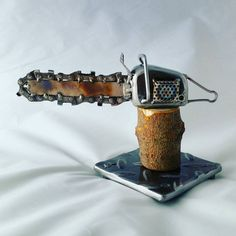 Check out this item in my Etsy shop https://www.etsy.com/listing/267778467/custom-made-scrap-metal-art-chainsaw