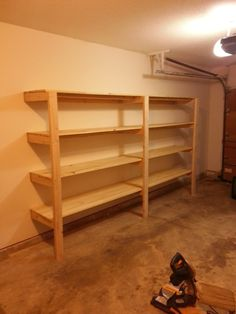 "Storage for tubs, but paint walls first, then paint shelves espresso to take away the ""garage look""!"