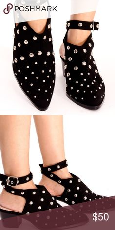 As seen on Top Shop: MADNESS Studded Booties 💋 Be the girl with the statement boots this season in this cool, black studded version. Featuring a mid heel and semi-pointed toe, it also features cut-out detail to the side for a fun twist. Upper multi strap, open back, ankle strap buckle, a chunky heels shoes measures about 2 inches. Jubis Boutique Shoes Ankle Boots & Booties
