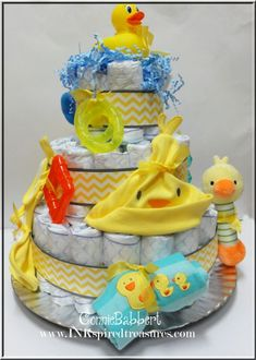 "Rubber Ducky Diaper Cake for a baby shower with a rubber duck theme ~ This could so easily be adapted to pretty much ANY theme; what a terrific idea, to ""theme"" it!!  8-)"