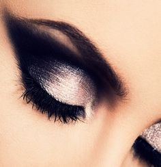 A timeless smokey eye. Add shimmery shadow, black eyeliner, and finally black shadow. Fake lashes top off this look. #makeup
