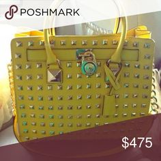 💛LAST PRICE💛 MK Citrus Pyramid Studded Hamilton In flawless like new condition! Bright limoncello yellow saffiano leather and warm gold hardware, none of which is tarnished or scratched except for the plate behind the gold MK padlock. This is typical and happens to all the studded Hamilton bc of the way the lock swings against the plate. Pretty rare and not easy to find! They've been discontinued by MK so their also sought after. I am looking for this exact bag in zinnia pink, black, or…