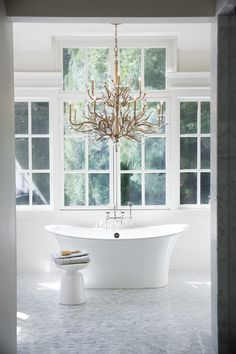 Eve 33 Inch 9 Light Chandelier - Eves graceful, hand-forged tubing creates a natural, vine-like pattern in a hammered Champagne Gold finish while faceted clear crystal buds emanate from the tips. Bathroom Lighting Design, Hinkley Lighting, Chandelier Lighting, Chandeliers, Dining Lighting, Ceiling Installation, Bathroom Goals, Bathroom Inspiration, Bathroom Inspo