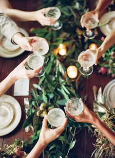 garlands on long tables with candles + petite vases.