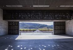 "These photographs taken by Yueqi ""Jazzy"" Li capture the ""mesmerising"" dappled light effect inside Herzog & de Meuron's Dominus Winery. Jacques Herzog, Wine Making Process, Public Hotel, Dappled Light, Contemporary Building, Interesting Buildings, Polished Concrete, Custom Lighting, Architect Design"