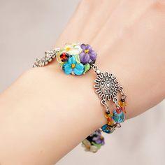 Ladybug floral lampwork bracelet glass flowers by KatyaGlass