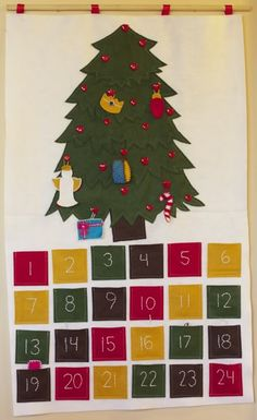 Felt Christmas tree with advent ornaments!!! And...the large felt wall tree so the kiddies leave the real one alone!