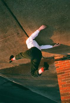 man jumping up, upside down, photography