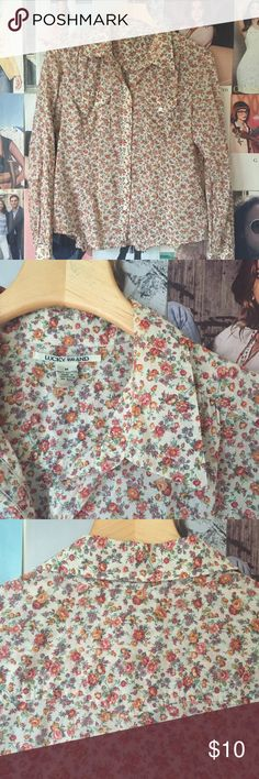 lucky brand + button up I've gotten lots of wear out of this floral shirt, and being of good Lucky Brand quality it has lots of wear left. Two front pockets, subtle western styling on the back, 2 button cuffs. Great condition. Lucky Brand Tops