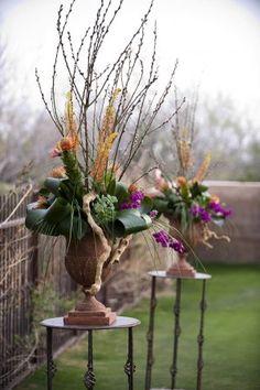 Tall-Tropical-Wedding-Ceremony-Arrangements