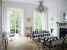 Georgian Townhouse in London, designed by Harriet Anstruther Studio. loving the striped sofa upholstery exposed backs herringbone wood floors and traditional chandelier