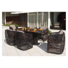 Dynasty Collection by Skyline  With sensual curves and comfy cushioning, the low maintenance Dynasty dining set begs for bottoms. Made of 100 percent recyclable material and all-weather proof fibres, it's a spanking good look.  www.skylinedesign.com