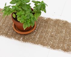 Crocheted twine table runner in natural jute twine with white cotton edging. $60.00, via Etsy.