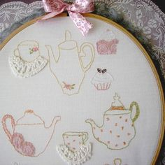 Embroidery ~ love the use of bits of lace