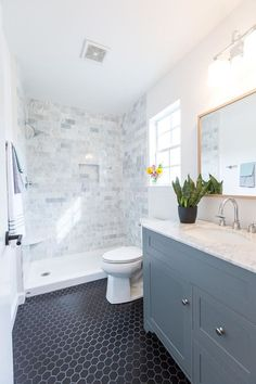 Carrara Marble Tile Shower Surround, Black Hex Tile, Gray Vanity With  Carrara Marble Top