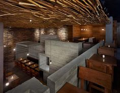 Geometric restaurant design. Love the juxtaposition of the concrete with the stick ceiling. #design #restaurant #modern